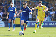 AFC Wimbledon defender Steve Seddon (15) dribbling and being chased by Bristol Rovers midfielder Alex Rodman (33)during the EFL Sky Bet League 1 match between AFC Wimbledon and Bristol Rovers at the Cherry Red Records Stadium, Kingston, England on 19 April 2019.