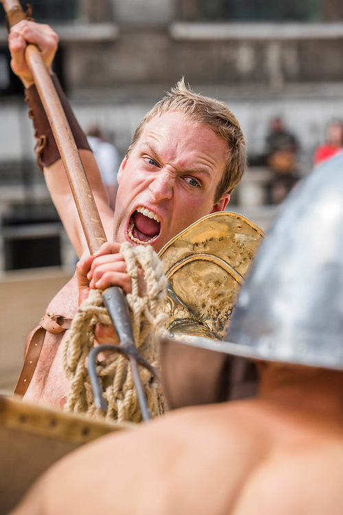 A Retiarius with trident and net fights a Secutor - Gladiators gather on the site of London's only performers that worked on Ridley Scott's Gladiator film will clash on the spot where gladiators battled 2,000 years ago in the courtyard of the Guildhall. Ten public evening and matinee performances will take place on selected dates between 8 and 16 August. Full information and tickets at www.museumoflondon.org.uk<br /> <br /> <br /> Hidden for centuries, the ancient remains of London's Roman amphitheatre were discovered by archaeologists in 1988. They are open for viewing all year. The Gladiator Games are performed by Britannia, renowned for its work on the Ridley Scott film, Gladiator. Each performance is the result of research into events in the 1st century A.D., using images drawn from Roman coins, paintings, sculpture and mosaics.