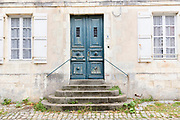 Typical street scene quaint house with weatherworn door, shutters traditional architecture, St Martin de Re, Ile de Re, France