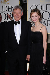 """File photo : Harrison Ford and Calista Flockhart  arriving for the 69th Annual Golden Globe Awards Ceremony, held at the Beverly Hilton Hotel in Los Angeles, CA, USA on January 15, 2012. The 72-year-old, star of the Indiana Jones and Star Wars films, reported engine failure and crash-landed his vintage plane on a Venice golf course in Los Angeles. He was breathing and alert when medics arrived and took him to hospital in a """"fair to moderate"""" condition, a fire department spokesman said. Photo by Lionel Hahn/ABACAPRESS.COM  