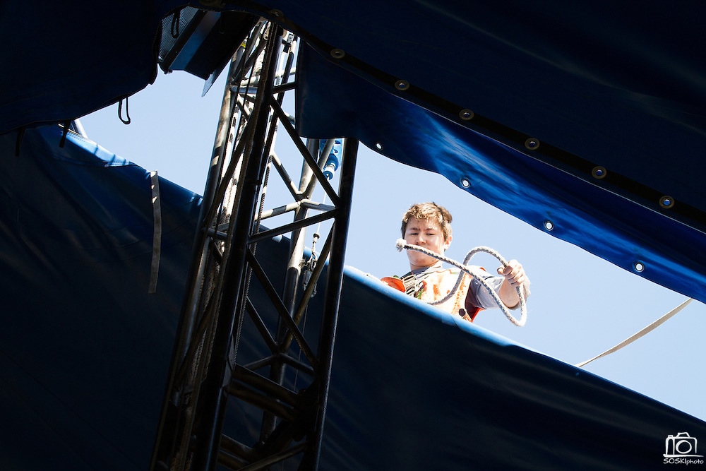 Circus Vargas prepares for a weekend worth of performances at the Great Mall in Milpitas, Calif., by erecting their main tent and cleaning performance lights on Aug. 28, 2012.  Photo by Stan Olszewski/SOSKIphoto.