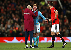 Manchester City's Kevin De Bruyne (centre) receives treatment after picking up an injury
