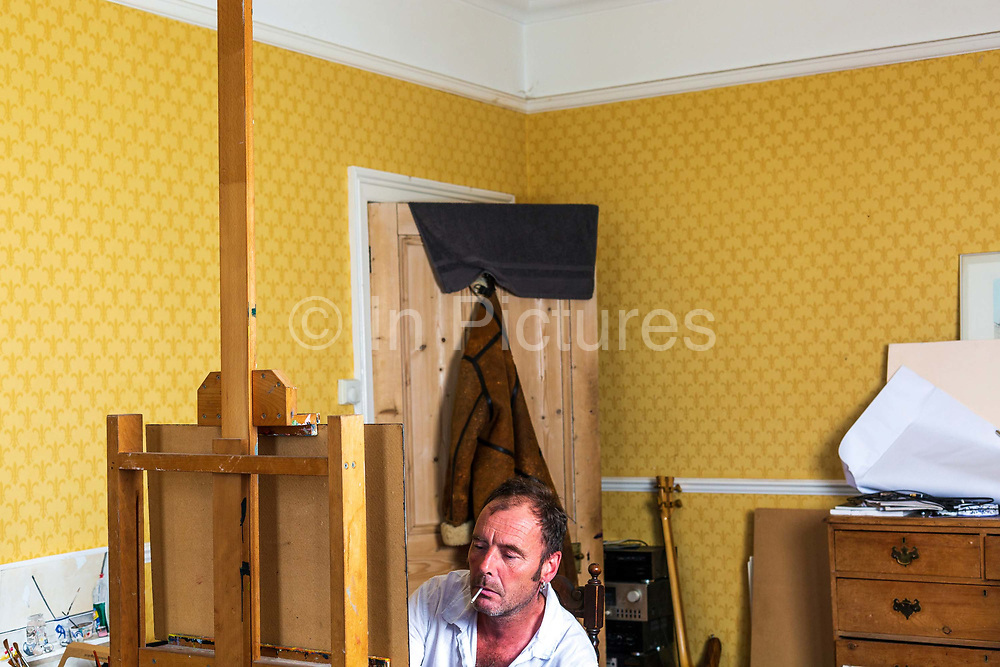 James Mackinnon, a contemporary British artist in his studio in Hastings, United Kingdom. Grandson of the highly regarded painter and teacher Hugh Mackinnon, James was born in London, England in 1968. His first exhibition was in 1994, where he collaborated with the photographer Tom Hunter who was awarded the John Kobal Portrait Award. Since then he has been exhibiting with a number of museums and galleries including the Museum of London, the Paton Gallery, the Millinery Works Gallery and more recently Cosa.