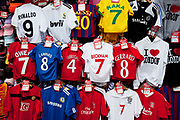 Cheap football shirts for sale at a stall on Oxford Street in Central London. This is a busy shopping area full of all the main high street chain stores.