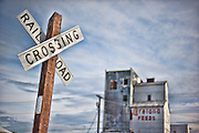 A railroad crossing sign and feed building in Missoula, Montana. Missoula Photographer, Missoula Photographers, Montana Pictures, Montana Photos, Photos of Montana