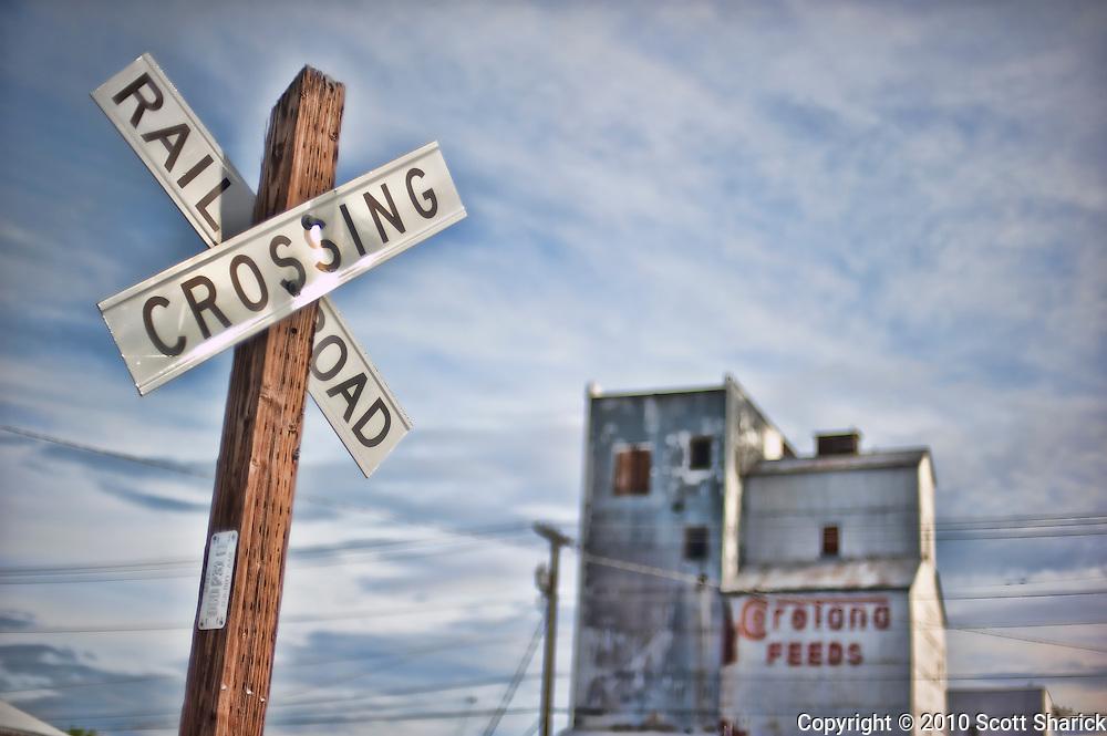 A railroad crossing sign and feed building in Missoula, Montana. Missoula Photographer, Missoula Photographers, Montana Pictures, Montana Photos, Photos of Montana