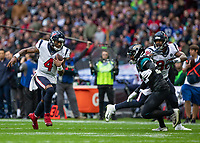 American Football - 2019 NFL Season (NFL International Series, London Games) - Houston Texans vs. Jacksonville Jaguars<br /> <br /> Deshaun Watson, Quarterback,(Houston Texans) chooses to run rather than throw at Wembley Stadium.<br /> <br /> COLORSPORT/DANIEL BEARHAM
