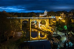 © Licensed to London News Pictures. 10/01/2020. Knaresborough UK. A train leaves a light trail as it crosses Knaresborough Viaduct over the River Nidd during the twilight hour this morning in the Yorkshire town of Knaresborough. The castellated viaduct was built in 1851 by Thomas Grainger for the Leeds & Thirsk Railway. Photo credit: Andrew McCaren/LNP
