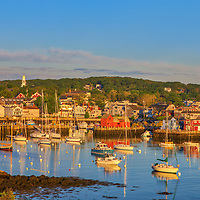 Cape Ann scenic seaview of Rockport Harbor, Motif Number One and its Massachusetts and its fishing and pleasure boats pinted in beautiful warm hues of the sunrise golden light.<br /> <br /> Sailing Boats at Rockport on Cape Ann photography images are available as museum quality photo, canvas, acrylic, wood or metal prints. Wall art prints may be framed and matted to the individual liking and New England interior design projects decoration needs.<br /> <br /> Good light and happy photo making!<br /> <br /> My best,<br /> <br /> Juergen