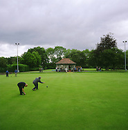 People playing crown green bowling at a green in Victoria Park, Warrington which runs adjacent to the river Mersey and Manchester Ship Canal. The Mersey is a river in north west England which stretches for 70 miles (112 km) from Stockport, Greater Manchester, ending at Liverpool Bay, Merseyside. For centuries, it formed part of the ancient county divide between Lancashire and Cheshire.