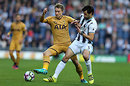 Christian Eriksen of Tottenham Hotspur (l) is challenged by Claudio Yacob of West Bromwich Albion. Premier league match, West Bromwich Albion v Tottenham Hotspur at the Hawthorns stadium in West Bromwich, Midlands on Saturday 15th October 2016. pic by Andrew Orchard, Andrew Orchard sports photography.