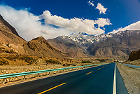 Karakoram Highway passing through the Pamir Mountains in Xinjiang China. It is the highest paved international road in the world; it connects Western China and Pakistan. It is one of the very few routes that cross the Himalayas and the most westerly of them. Historically, this was a caravan trail, one branch of the ancient Silk Road.