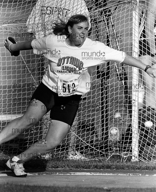 ******This is an unprocessed scan from the negative. You can buy it as is and clean it up yourself, or contact us for rates on providing the service for you. *******<br /> <br /> (Montreal, Canada --- 25 July 1995) Wendy Phillips in the discus at the 1995 Canadian National Track and Field Championships held at the Complexe sportif Claude-Robillard in Montreal. Photo 1995 Copyright Sean Burges / Mundo Sport Images.<br /> <br /> ******This is an unprocessed scan from the negative. You can buy it as is and clean it up yourself, or contact us for rates on providing the service for you. *******