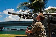 Young boy looking at Anti-Aircraft guns, Pearl Harbor, Oahu, Hawaii