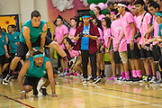 Milpitas High School juniors hop over each other during the Leap Frog race during the annual Trojan Olympics, where students compete in various unorthodox events for class bragging rights, at Milpitas High School in Milpitas, California, on March 27, 2015. (Stan Olszewski/SOSKIphoto)