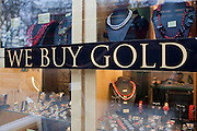 A 'We Buy Gold' sign in the window of a central London gold shop.