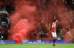 Fans set of a flare in the stands during the Premier League match at Old Trafford, Manchester.