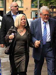 Licensed to London News Pictures. London, UK. 04/06/2014. Former BBC TV entertainer ROLF HARRIS arrives at Southwark Crown Court in London today (04/06/2014) with his daughter Bindi Harris, left, as the trial continues for 12 charges of indecent assault.