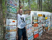 Lazarus Lake hangs license plates, part of the entry process for virgins, from past runners at the Barkley Marathons.