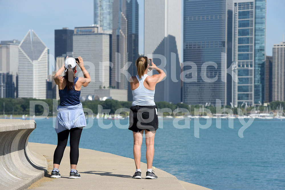 Walkers along the Chicago lakefront in Chicago, Illinois.<br /> Photo by Mark Black