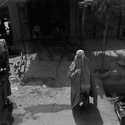 A woman in a burqa walks amongst vendors stalls in one of the many bazaars in the sprawl of Kandahar City, Afghanistan. Kandahar City is the second largest city in the country and one of the main economic engines of the country. (Credit Image: © Louie Palu/ZUMA Press/The Alexia Foundation).....