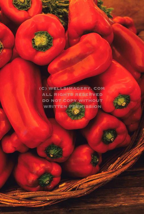 Image of red peppers at a farmer's market in Rome, Italy by Randy Wells