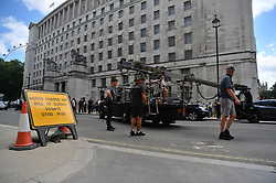 A camera crew outside the Ministry of Defence as the filming for the upcoming Bond film takes place on the Mall in London. The as-yet-untitled project has been shooting in Jamaica and at Pinewood Studios but the official 007 Twitter account confirmed the spy movie is now filming in the capital.