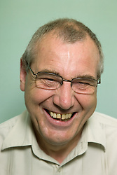 Portrait of an older man laughing,