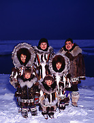 The Rexford fammily wearing traditional Eskimo parkays made by Nora Rexford (top center), Arctic Ocean Coast, Barrow, Alaska.<br /> Please Note that use of this photograph requires that a small extra licensing fee be paid to the Rexford family.  Please contact Fred Hirschmann for information.