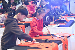 February 5, 2018 - Taiyuan, Shanxi, China - Hundreds of cute kids write brush calligraphy spring festival scrolls to welcome the tradtional Chinese New Year in Taiyuan, Shanxi, China on 05th February 2018. (Credit Image: © TPG via ZUMA Press)