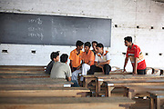 """INDIA's School for the Poor but Gifted<br /><br />""""If one is accepted to walk into this door; He will walk out with all the doors of the world probably thrown open to him"""".<br />So remarked student Satish Kumar,18, casually pointing towards the tattered tin door of the Ramanujan School of mathematics located amidst the narrow muddy  water logged bylanes of Patna, Bihar. <br />He continues,""""Me and many others like me are examples of this, in spite of being poor we now feel of being second to none.""""<br />The reason for  Satish kumar's new found confidence is that he is one amongst the 30 of the poorest but talented students  in Bihar who had been selected to be a part of a batch known as the SUPER 30, and who after a complete year's hard work have now   passed the entrance test of the IIT JEE 2009 (Indian Institute of Technology's Joint Entrance Examination ) with flying colors. <br />This  guarantees him a berth in one of the 15 IIT's spread across India, the topmost &  elitist Technology Colleges in India; the Indian equivalent of the Ivy league colleges. IITs are  the technological haven and boast of an alumni like Sabeer Bhatia, the inventor of Hotmail & N.R. Narayana Murthy founder of  Infosys and many others who are right now running the most prestigious blue chip companies around the world. It can lay claim of having  created some of the world's brightest tech wizards and engineering geniuses in recent times.<br /><br />With such credentials it is given that the IITs are notoriously selective in their admission procedure. About 384,977 students took their Joint Entrance Test (IIT-JEE) this year, hankering after 8,295 seats, indicating an admission rate of around two per cent, the most competitive in the world. (That at Princeton, Yale, and Harvard hovers around nine per cent).<br />  """"Our only hope of  entry into IIT and out of poverty was  the SUPER 30. It was our only talisman."""" Says another successful student  Nagendra Ram.<br /><br />Super-30  is   what dre"""