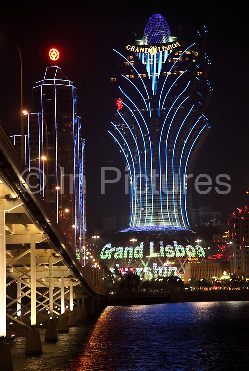 A view of Stanly Ho's Grand Lisboa at night in Macau, China on 28 January 2011. A relative newcomer to the rapidly expanding Macau gambling scene, the Galaxy hopes its new casino will hold up its own against the likes of the Venetian, Wynn, MGM, and the Lisboa.