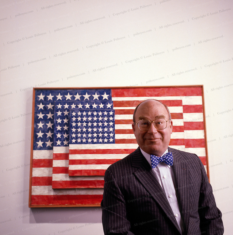 Tom Armstrong at the Whitney Museum in New York City with Jasper Johns painting.