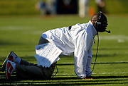 Virginia head coach Mike London falls to his knees after a substitution penalty during the fourth quarter of an NCAA football game on Saturday in Charlottesville, Va. Photo / Ryan M. Kelly / The Daily Progress