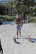 MIAMI, FL,USA  SIMON COWELL WALKING HIS DOGS ON THE BEACH OF MIAMI<br /> ©Exclusivepix