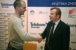Jan Zumer and president of AZS dr. Peter Kukovica when Athletic Federation of Slovenia (AZS) and top Slovenian athletes sign a contract of sponsorship, on February 14, 2008 in M-Hotel, Ljubljana, Slovenia. (Photo by Vid Ponikvar / Sportal Images)