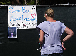 July 21, 2017 - Los Angeles, California, U.S - Fans place flowers at a memorial site outside of the home of Chester Bennington in Palos Verdes Estates, California, on Friday, July 21, 2017. Chester Bennington, lead singer of alt-rock band Linkin Park, was found dead on Thursday morning in his Palos Verdes Estates home of an apparent suicide. He was 41. (Credit Image: © Ringo Chiu via ZUMA Wire)