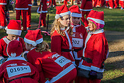 Runners discuss strategy before the start - Thousands of runners, of all ages, in santa suits and other Christmas costumes runaround Clapham Common for Great Ormond Street Hospital and for fun. London 30 Nov 2016