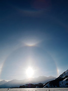 Low winter sun on a subzero day with sun dogs or parahelia, 22º halo and tangent arcs,  and supralateral arc touching a circumzenithal arc with a faint 46º halo below, all above the frozen Slims River, Kluane Ranges, Kluane Naitonal Park, Yukon Territory, Canada