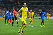 Romania Forward Bogdan Stancu celebrates his penalty goal during the Group A Euro 2016 match between France and Romania at the Stade de France, Saint-Denis, Paris, France on 10 June 2016. Photo by Phil Duncan.