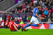 Alim Ozturk of Sunderland (5) tackles Gareth Evans of Portsmouth (26) during the EFL Sky Bet League 1 first leg Play Off match between Sunderland and Portsmouth at the Stadium Of Light, Sunderland, England on 11 May 2019.