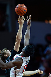 NORMAL, IL - October 23: Cade McKnight gets the tip over Rey Idowu during a college basketball game between the ISU Redbirds and the Truman State Bulldogs on October 23 2019 at Redbird Arena in Normal, IL. (Photo by Alan Look)