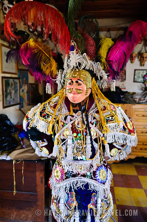 A man poses in full costume of a Spanish conquistador in Chichicastengo. Historic masks and costumes used for festivals and celebrations in Chichicastengo. The town has become famous for its masks which depict a combination of indigenous characters as well as Catholic saints and Spanish conquistadors. Chichicastenango is an indigenous Maya town in the Guatemalan highlands about 90 miles northwest of Guatemala City and at an elevation of nearly 6,500 feet. It is most famous for its markets on Sundays and Thursdays.
