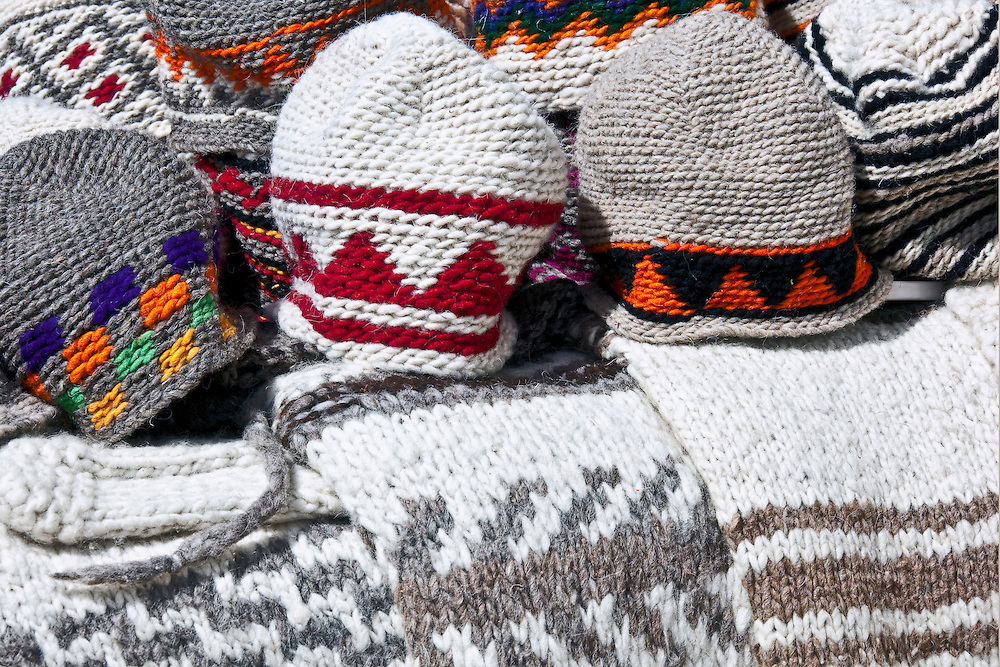 Knitted woollens. Traditional woollen caps and sweaters at a seller in the medina of Essaouira.