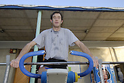 Seville. SPAIN, 16.02.2007. Josh WEST, works out on the exercise cycle at the Seville Training Centre, on the  FISA Team Cup [Photo Peter Spurrier/Intersprt Images]    [Mandatory Credit, Peter Spurier/ Intersport Images].   [Mandatory Credit, Peter Spurier/ Intersport Images]. , Rowing Course: Rio Guadalquiver Rowing Course, Seville, SPAIN,