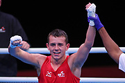 Peter Mcgrail of Great Britain (red) celebrates beating Kevin Godla of The Czech Republic (bue) in the Men's Featherweight preliminaries during The Road to Tokyo European Olympic Boxing Qualification, Sunday, March 15, 2020, in London, United Kingdom. (Mitchell Gunn-ESPA-Images/Image of Sport)