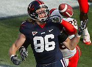 Virginia tight end Chris Santi has a pass blocked by a Maimi defender during a college football game.