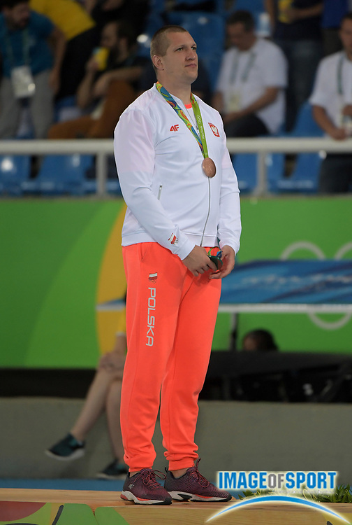 Aug 20, 2016; Rio de Janeiro, Brazil; Wojciech Nowicki (POL) poses with bronze medal after placing third in the hammer during the 2016 Rio Olympics at Estadio Olimpico Joao Havelange. <br /> <br /> *