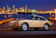 Automotive Photographer and Promotional Writer Randy Wells, Image of a tan sports car and the Seattle skyline in Seattle, Washington, Pacific Northwest, Porsche 1967 911S, property released