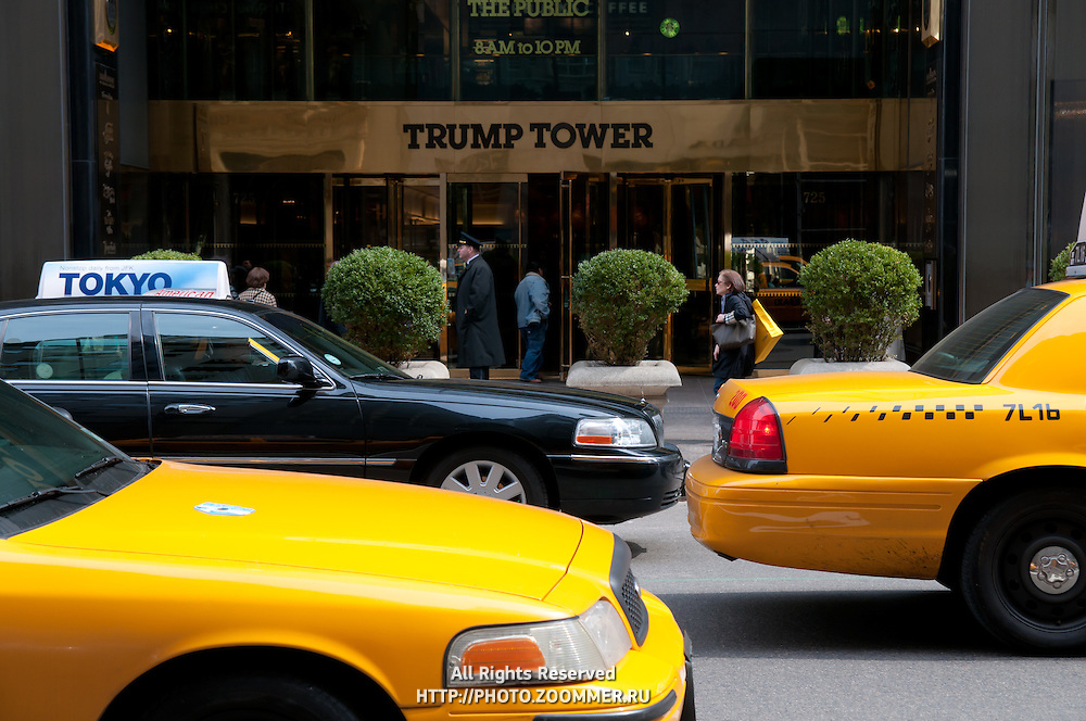 The doors of the Trump Tower in Manhattan. NYC taxis near the Trump Tower.